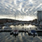 Marina with cloud reflections
